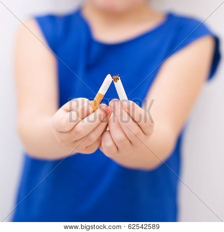 Young Girl Is Breaking A Cigarette