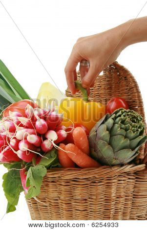 hand taking vegetable