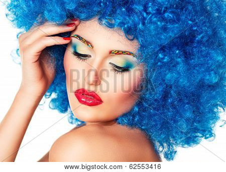 Portrait Of A Young Beautiful Girl With Bright Makeup In Blue Wig