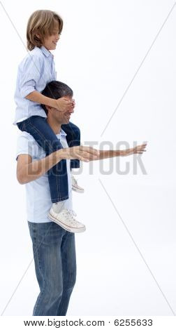 Man Giving Son Piggyback Ride With Eyes Closed