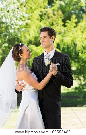 Young newly wed couple dancing on wedding day