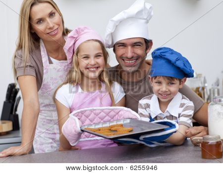 Family Baking Cookies In The Kitchen