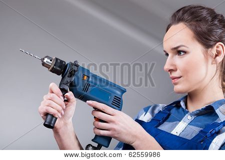 Woman Using A Drill