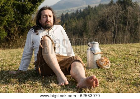 Eremit In The Nature With Fresh Milk And Bread