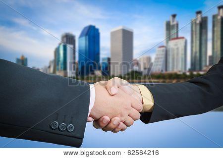 Businessman Handshake With Building Area Background