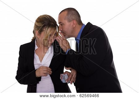 Man Whispering To Woman