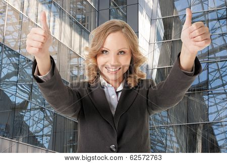 young beautiful woman showing thumbs up, smiling