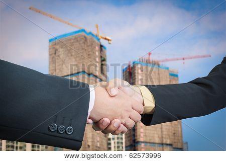 Businessman Handshake With Building Construction Background