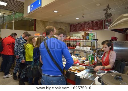 ADLER, SOCHI, RUSSIA - FEBRUARY 12, 2014: People in the cafe of Olympic Park train station. Locals prefer cafes and restaurants outside of Olympic venues due to their much cheaper prices