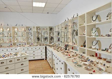 Interior decoration of jewelry store with exhibition display shelfs