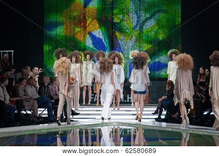 ZAGREB, CROATIA - MARCH 28, 2014: Fashion models wearing clothes designed by Marina Design and Marija Ivanovic accessories on the 'Fashion.hr' fashion show