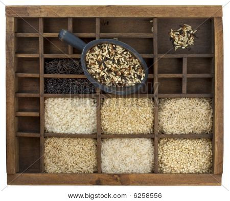 Variety Of Rice Grains In Vintage Wooden Drawer With Scoop