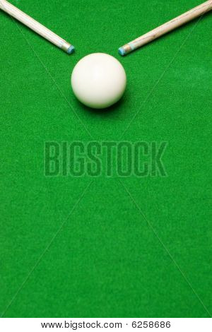 Two Pool Cues In Corners With A Ball