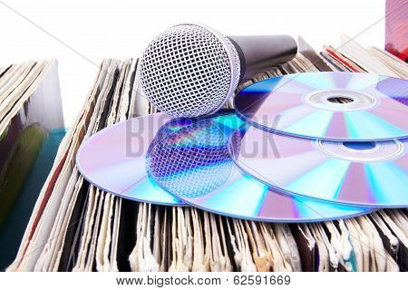 Compact Disks And Microphone On Records