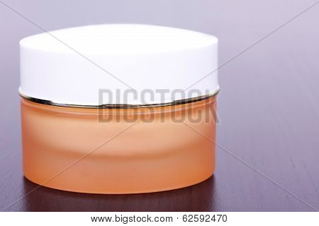 Cream In Yellow Box On Black Table