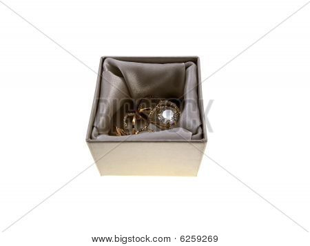 Gold Jewelry In A Grey Box