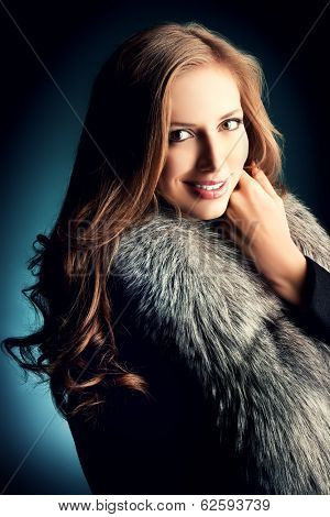 Portrait of a beautiful woman in a jacket with fur.