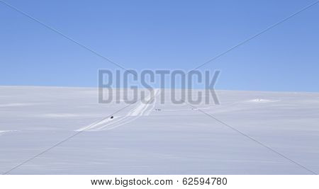 Snowmobile and snowmobile tracks in the Nordic mountains.