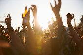 stock photo of singing  - Crowds Enjoying Themselves At Outdoor Music Festival - JPG