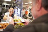 stock photo of poverty  - Kitchen Serving Food In Homeless Shelter - JPG
