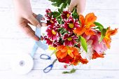 image of compose  - Female hands composing beautiful bouquet - JPG