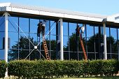 picture of window washing  - Two window cleaners at work - JPG