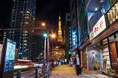Tokyo, Japan - November 28: View Of Busy Street At Night With Tokyo Tower In The Distance