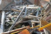 image of ferrous metal  - rusted iron beams abandoned and other network waste of ferrous material in a landfill - JPG