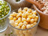stock photo of bean sprouts  - Chick peas and green mung bean sprouts in bowl - JPG