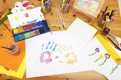 stock photo of arts crafts  - different things lying on a table to try arts and crafts painted by kids - JPG