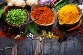 picture of yellow-pepper  - Spices and herbs over Wood - JPG
