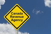 stock photo of revenue  - Canada Revenue Agency Warning Sign A Canadian road warning sign with words Canada Revenue Agency with a sky background - JPG