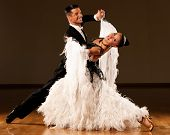 stock photo of waltzing  - Professional ballroom dance couple preform an romantic exhibition dance - JPG