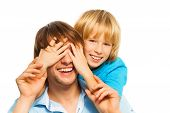 picture of guess  - Young happy smiling father guesses who with his son cover face with palms - JPG