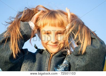young girl in the sunset light