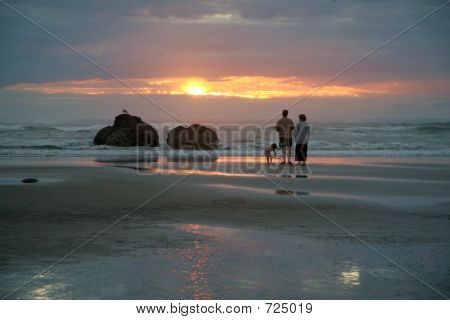Family At Sunset Beach