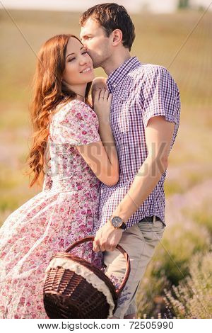 Loving couple in a field of lavender