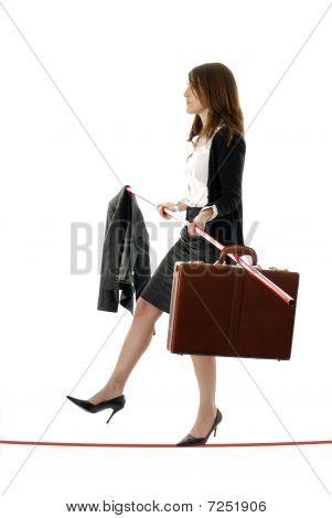 Business woman tightrope walker