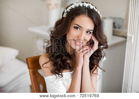 Portrait of the happy bride waiting for a wedding.