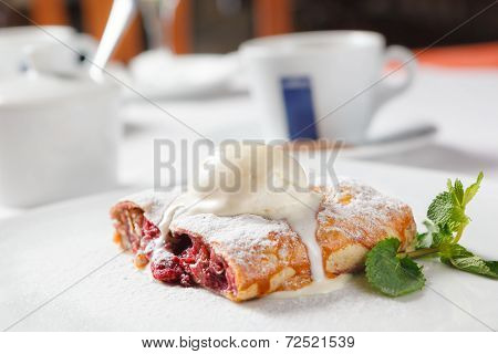 Cherry Strudel With Ice Cream And Mint Leaf.