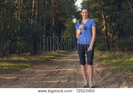 Fit Young Woman Drinking Bottled Water