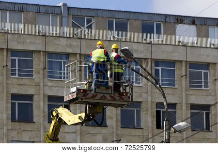 Electricians Reparing Street Lights
