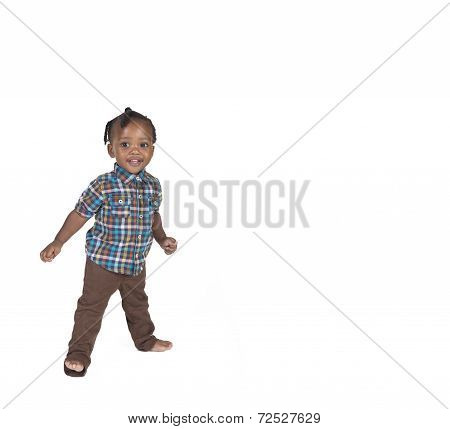 Young toddler isolated against a white background
