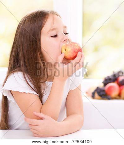 Little Girl Eating An Apple