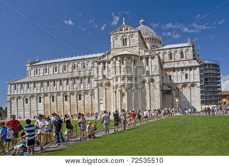 Tourists Visiting The Cathedral In Pisa, Italy