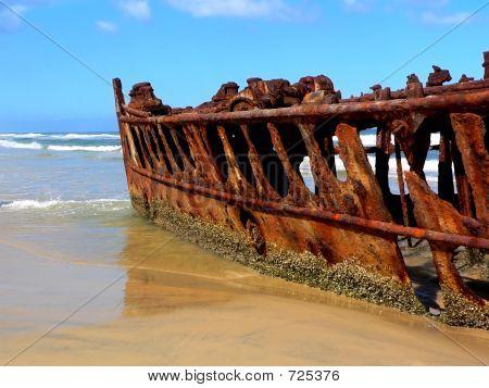 Rusty Shipwreck on Tropical Beach