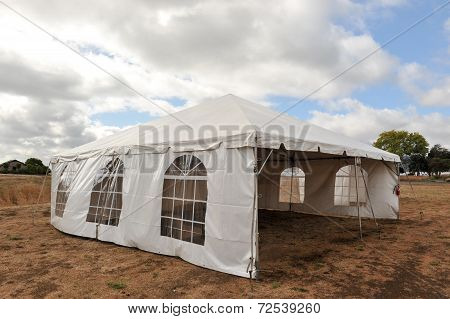 White Tents In A Dry Field Outdoors
