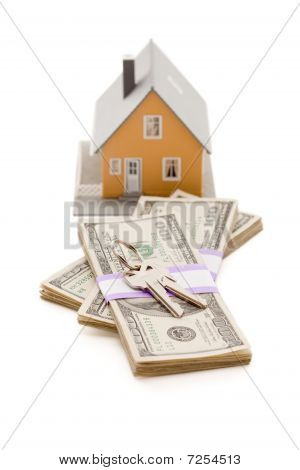 Home And House Keys On Stack Of Money Isolated
