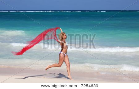 Young Female Running  On Tropical Beach
