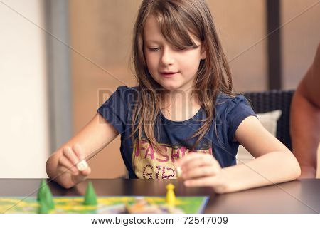Girl Playing Board Game